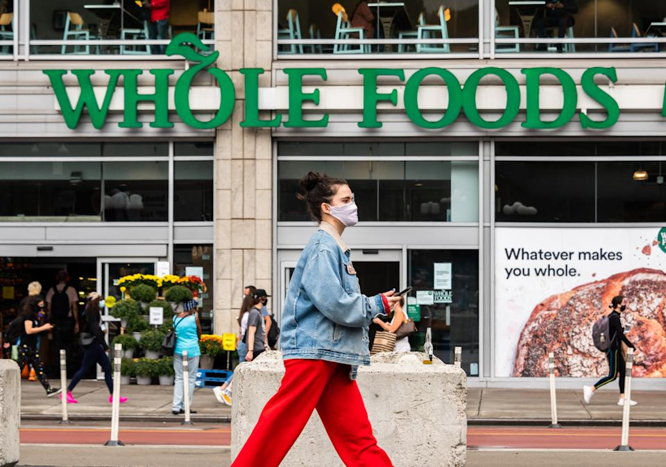 A person wears a face mask outside Whole Foods Market in Union Square as the city continues Phase 4 of re-opening following restrictions imposed to slow the spread of coronavirus on September 29, 2020, in New York City. (Photo by Noam Galai/Getty Images)