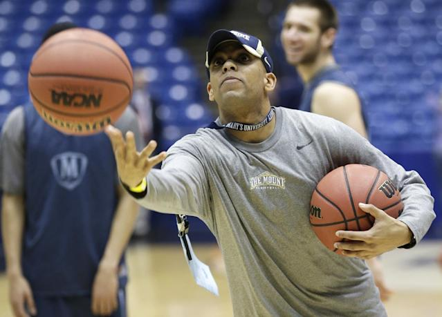 Mount St. Mary's head coach Jamion Christian tosses a ball during practice for an NCAA college basketball tournament game Monday, March 17, 2014, in Dayton, Ohio. Albany plays Mount St. Mary's on Tuesday in a first round game. (AP Photo/Al Behrman)