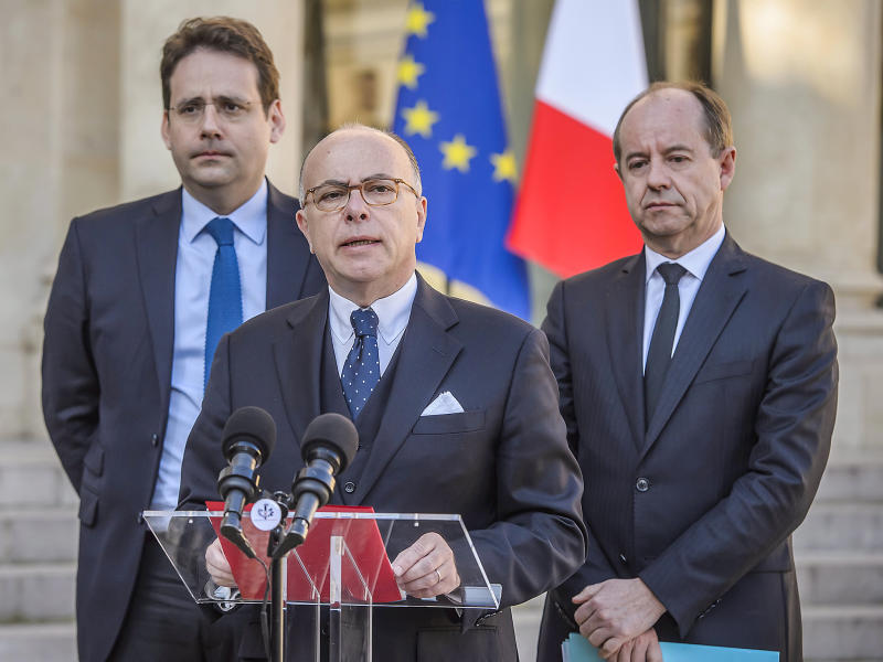 Bernard Cazeneuve (centre), flanked by interior minister Matthias Fekl (left) and justice minister Jean-Jacques Urvoas (right), outside the Elysee Palace in Paris on Friday: EPA