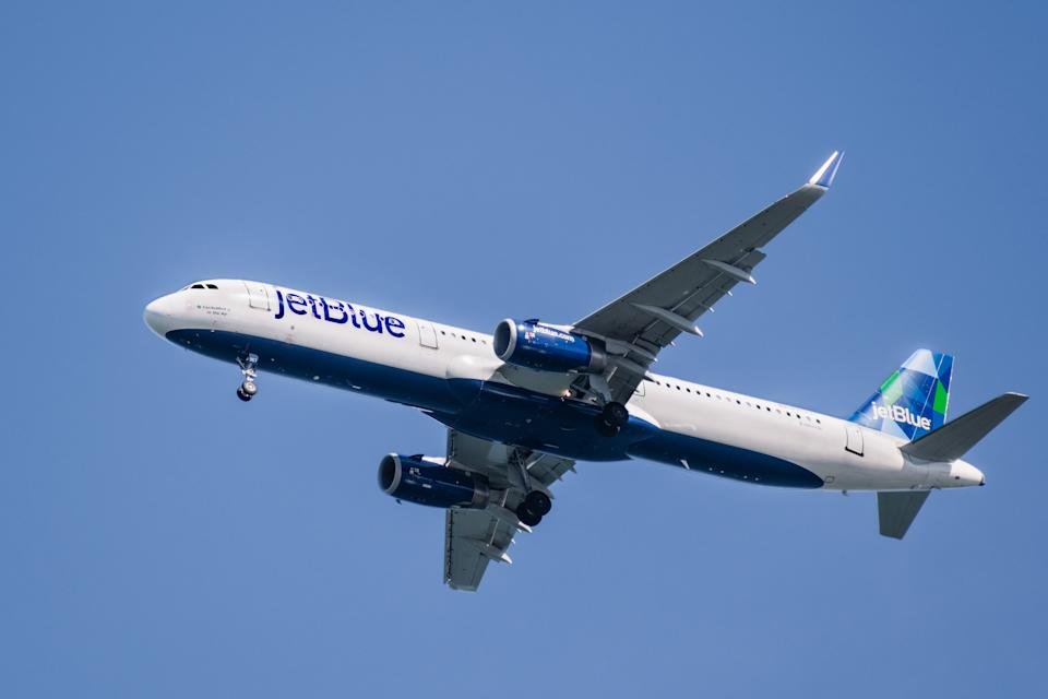 Feb 19, 2020 San Francisco / CA / USA - JetBlue aircraft preparing for landing at San Francisco Airport; JetBlue Airways Corporation, stylized as jetBlue, is a major American low cost airline