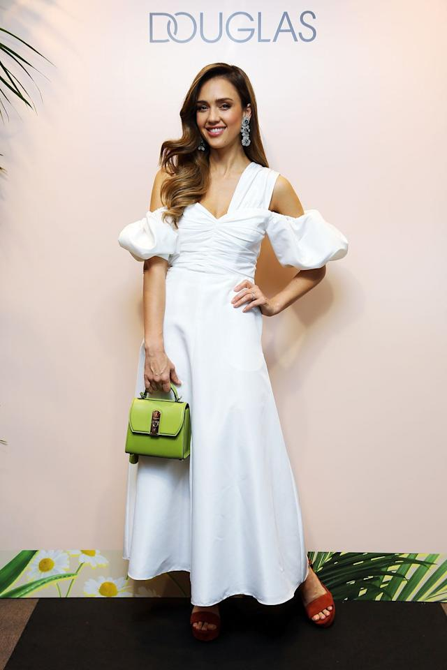 <p><strong>23 June </strong>Jessica Alba added a pop of colour to her white Self-Portrait dress with a lime green bag and red sandals at her Honest Beauty line event in Rome. <strong></strong></p>