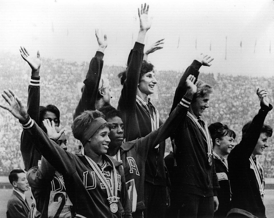 <p>The Polish winners of the women's 4x100 Meters Relay Race celebrate at the top of the podium, while the second-place American team and third-place British team wave to fans as well. </p>