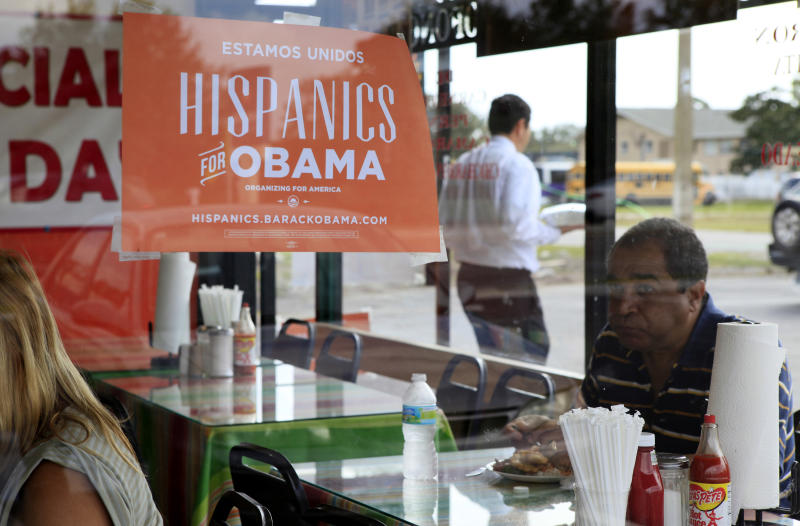 FILE - In this Oct. 26, 2012, file photo, Spanish language election campaign signs promoting President Barack Obama hang on the windows at Lechonera El Barrio Restaurant in Orlando, Fla. Hispanics supported President Barack Obama over Republican Mitt Romney by almost 3-to-1 and put Republicans on notice they must take real steps to win over the nation's largest minority group if they want to win the presidency again. Exit polls say that Romney, who has backed hardline immigration measures, won only 27 percent of Hispanics. (AP Photo/Julie Fletcher)