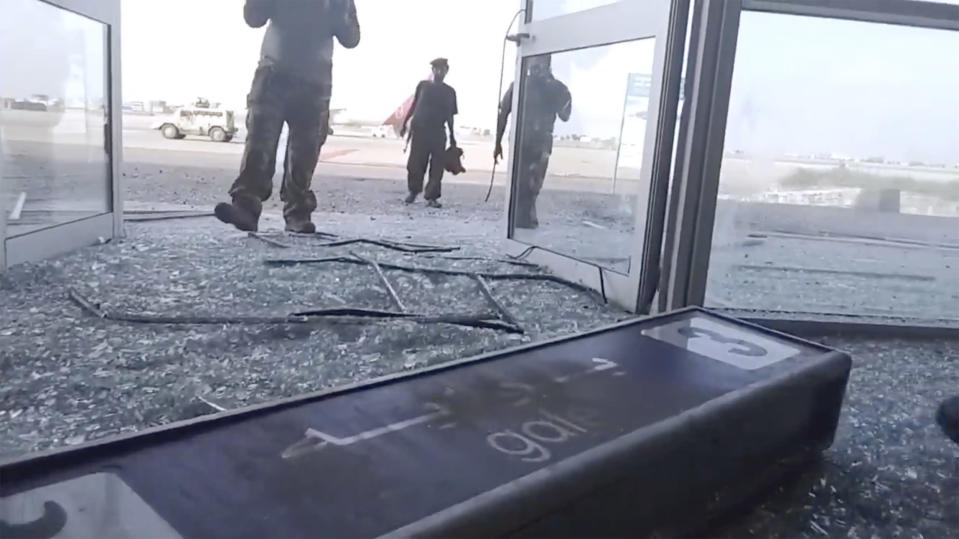 Glass and debris covers the damaged portion of the airport in Yemen's southern city of Aden after an explosion, Wednesday, Dec. 30, 2020. The blast struck the airport building shortly after a plane carrying the newly formed Cabinet landed on Wednesday. No one on the government plane was hurt. (AP Photo)
