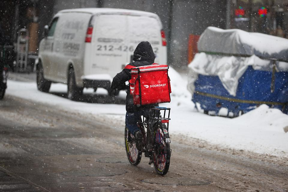 NEW YORK, USA - FEBRUARY 18: A food delivery guy with bicycle is seen as snowfall blankets the Times Square in New York City, United States as massive snow storm hits the east coast on February 18, 2021. (Photo by Tayfun Coskun/Anadolu Agency via Getty Images)