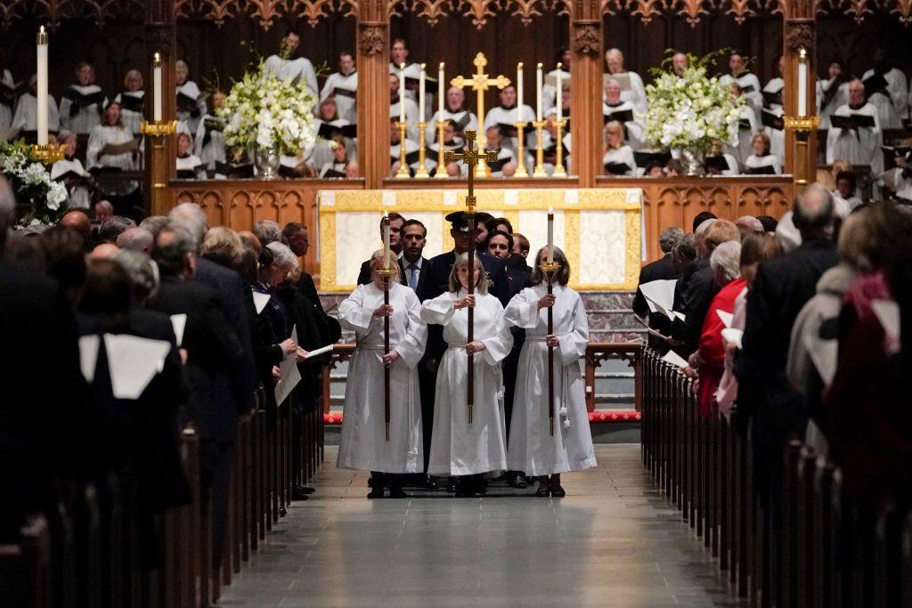 <p>The family is escorted down the aisle following the service.</p>