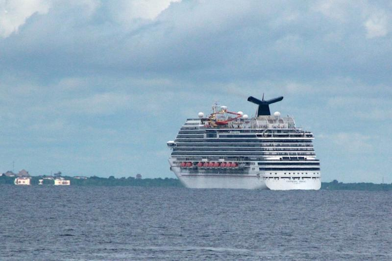 The cruise ship Carnival Magic passes near Cozumel, Mexico, on Friday.