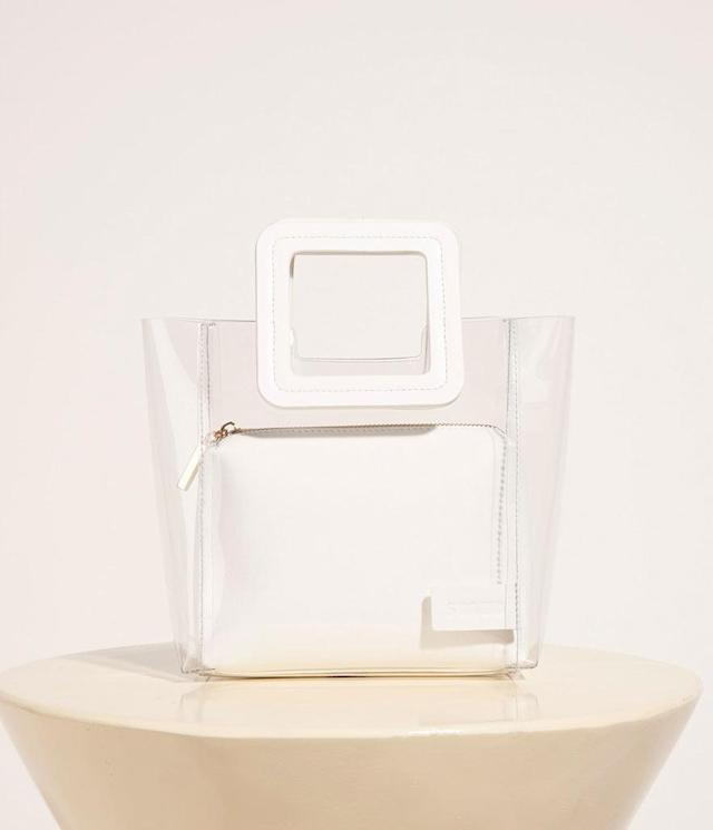 """<p>Mini Shirley Bag Clear, $195,<a href=""""https://staud.clothing/collections/bags-accessories/products/mini-shirley-bag-clear-tan-faux-croc?variant=4433504010251"""" rel=""""nofollow noopener"""" target=""""_blank"""" data-ylk=""""slk:staud.clothing.com"""" class=""""link rapid-noclick-resp""""> staud.clothing.com</a> </p>"""