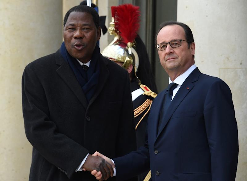 The party of President Thomas Boni Yayi, pictured with French President Francois Hollande in Paris, has won Benin's parliamentary elections with 33 seats out of 83 but failed to secure an absolute majority, according to the first partial results (AFP Photo/Dominique Faget)