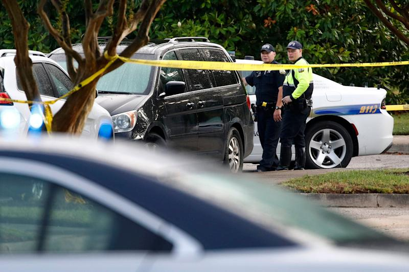 Law enforcement officials work outside a municipal building that was the scene of a shooting, June 1, 2019, in Virginia Beach, Va. A longtime city employee opened fire at the building Friday before police shot and killed him, authorities said. (Photo: Patrick Semansky/AP)