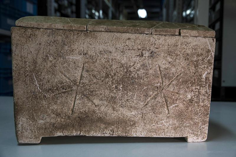 """An ossuary with an inscription of the Hebrew letters forming the word """"Yeshua"""", or Jesus, is stored in Israel's antiquities authority storeroom, in Beit Shemesh, Israel, Sunday, March 19, 2017. Israel's antiquities authority opened up its vast storeroom to reporters Sunday for a peek at select artifacts from the time of Jesus. Experts say they have yet to find direct archaeological evidence of the Jewish preacher who died on the cross and changed the course of history. (AP Photo/Tsafrir Abayov)"""