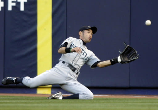 FILE - In this May 11, 2012, file photo, Seattle Mariners' Ichiro Suzuki, of Japan, dives to catch a ball hit by New York Yankees' Derek Jeter for an out during the first inning of a baseball game in New York. The Mariners finalized a one-year deal with 44-year-old Japanese star on Wednesday, March 7, 2018, after several outfielders got hurt. (AP Photo/Frank Franklin II, File)