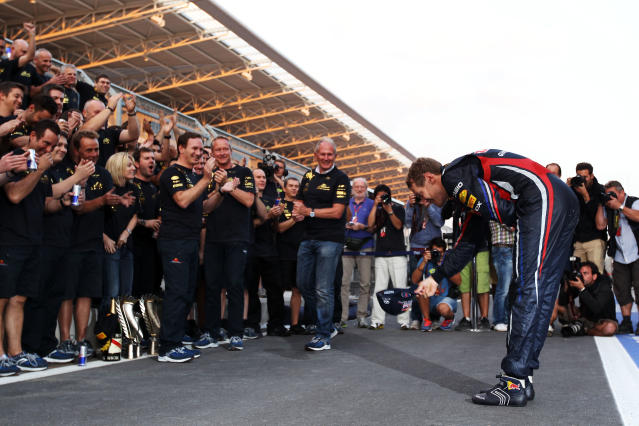 YEONGAM-GUN, SOUTH KOREA - OCTOBER 16: Sebastian Vettel of Germany and Red Bull Racing celebrates with team mates as they win the Constructors title following his victory in the Korean Formula One Grand Prix at the Korea International Circuit on October 16, 2011 in Yeongam-gun, South Korea. (Photo by Clive Rose/Getty Images)