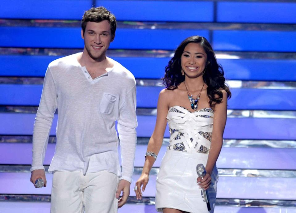 """FILE - In this May 23, 2012 file photo, finalists Phillip Phillips, left, and Jessica Sanchez appear onstage at the """"American Idol"""" Finale in Los Angeles. """"Idol"""" winner Phillip Phillips will receive the same $300,000 advance given to last year's winner Scotty McCreery upon completion of his first album, according to the contracts. Coming in second on """"American Idol"""" as Sanchez has, may still be a path to superstardom, but it no longer offers guaranteed paychecks worthy of the next pop idol or rock star. (Photo by John Shearer/Invision/AP, File)"""