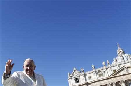 Pope Francis waves as he arrives to lead the general audience in Saint Peter's Square at the Vatican March 5, 2014. REUTERS/Alessandro Bianchi