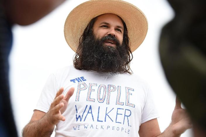 Chuck McCarthy discusses his passion for his work as a professional people walker in Los Angeles (AFP Photo/Robyn Beck)