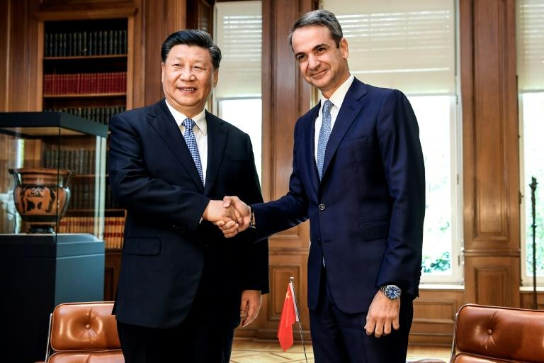 Chinese President Xi Jinping and Greek Prime Minister Kyriakos Mitsotakis talked trade during the Chinese leaders state visit to Greece (AFP Photo/ARIS MESSINIS)