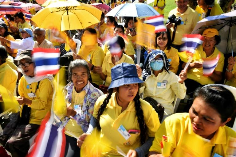 Thousands of well-wishers dressed in royal yellow sat along the banks of Bangkok's Chao Phraya river to get a real-life glimpse of Thailand's King Maha Vajiralongkorn