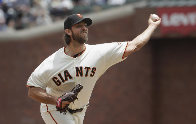 San Francisco Giants pitcher Madison Bumgarner throws to a Milwaukee Brewers batter during the third inning of a baseball game in San Francisco, Saturday, June 15, 2019. (AP Photo/Jeff Chiu)