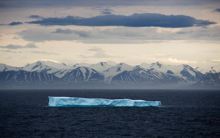 <p>JUL. 24, 2017 – An iceberg floats past Bylot Island in the Canadian Arctic Archipelago. Icebergs aren't sea ice, despite being best known for floating about the ocean. They are actually chunks of glaciers that have broken off at the water's edge. (Photo: David Goldman/AP) </p>