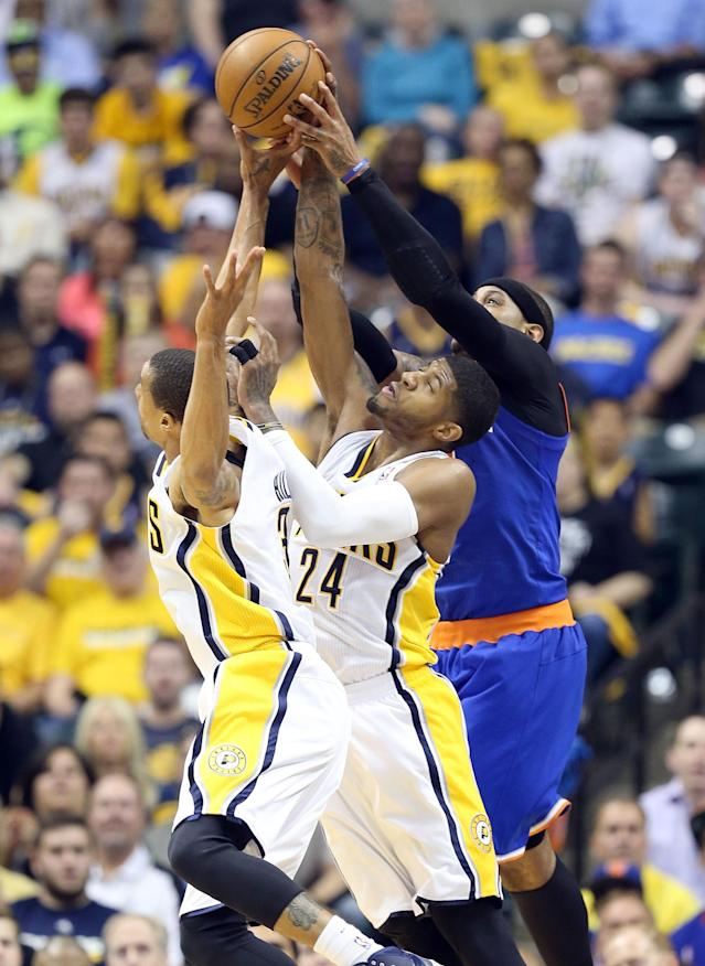 INDIANAPOLIS, IN - MAY 14: George Hill #3 and Paul George #24 of the Indiana Pacers and Carmelo Anthony #7 of the New York Knicks reach for a rebound during Game Four of the Eastern Conference Semifinals of the 2013 NBA Playoffs at Bankers Life Fieldhouse on May 14, 2013 in Indianapolis, Indiana. NOTE TO USER: User expressly acknowledges and agrees that, by downloading and or using this photograph, User is consenting to the terms and conditions of the Getty Images License Agreement. (Photo by Andy Lyons/Getty Images)