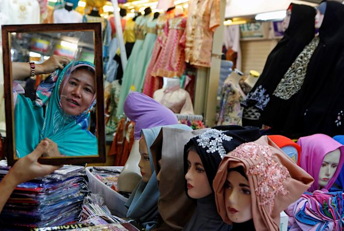 A woman shops for head scarves at Tanah Abang Textile Market ahead of the Muslim holiday of Eid al-Fitr, marking the end of Ramadan, in Jakarta, Indonesia June 20, 2017. REUTERS/Agoes Rudianto
