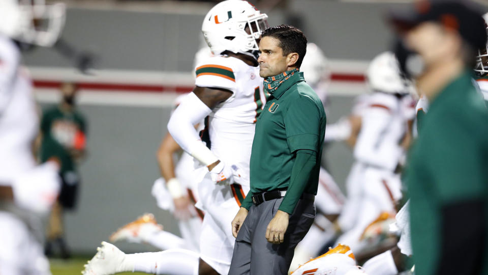 Miami coach Manny Diaz watches his players warm up for an NCAA college football game against North Carolina State on Friday, Nov. 6, 2020, in Raleigh, N.C. (Ethan Hyman/The News & Observer via AP, Pool)