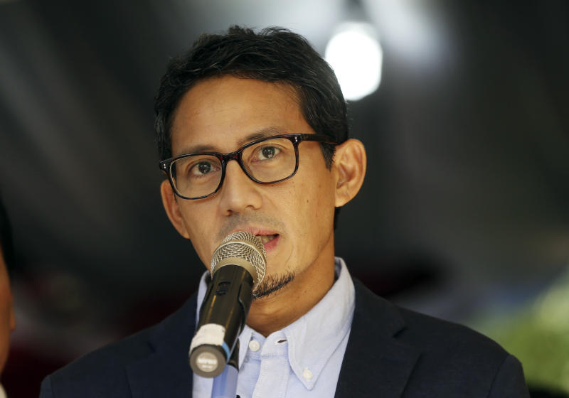 Indonesian vice presidential candidate Sandiaga Uno talks to journalists during a press conference in Jakarta, Indonesia, Friday, May 24, 2019. The defeated candidate in Indonesia's presidential elections has filed a challenge against the result in the country's top court just days after seven people died during rioting by his supporters in the capital. (AP Photo/Achmad Ibrahim)