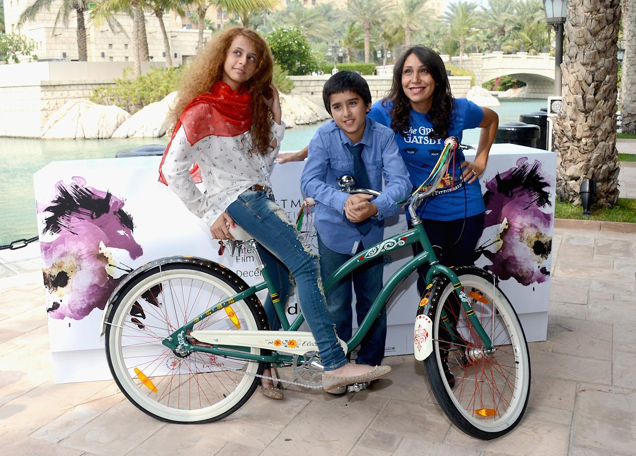 "DUBAI, UNITED ARAB EMIRATES - DECEMBER 12: Actors Waad Mohammed, Abdulrahman al Guhani and director Haifaa Al Mansour attend the ""Wadjda"" photocall during day four of the 9th Annual Dubai International Film Festival held at the Madinat Jumeriah Complex on December 12, 2012 in Dubai, United Arab Emirates. (Photo by Andrew H. Walker/Getty Images for DIFF)"