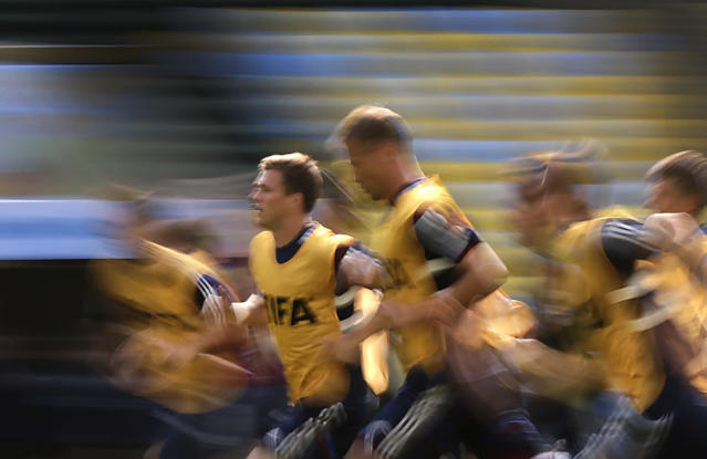 Maksim Kanunnikov, second left, of Russia's soccer team runs during a training session at the Maracana Stadium in Rio de Janeiro, Brazil, Saturday, June 21, 2014. Russia will play its next game against Belgium in group H of the 2014 soccer World Cup. (AP Photo/Wong Maye-E)