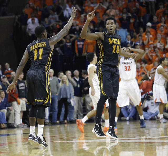 Virginia Commonwealth guard Rob Brandenberg (11) and Virginia Commonwealth forward Juvonte Reddic (15) celebrate their lead after a three-point shot during the second half of an NCAA college basketball game in Charlottesville, Va., Tuesday, Nov. 12, 2013. VCU won 59-56. (AP Photo/Steve Helber)
