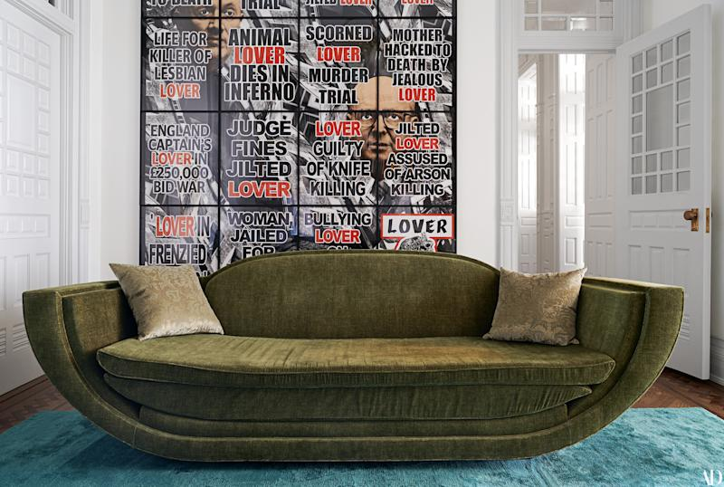 A custom sofa in the library. Gilbert & George artwork.