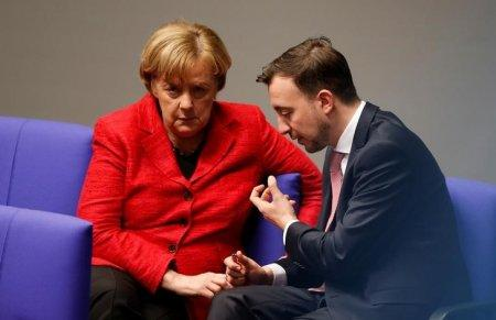 FILE PHOTO - German Chancellor Angela Merkel talks to Paul Ziemiak of the Junge Union, the youth Organisation of the CDU/CSU during a session of the Bundestag, German lower house of Parliament in Berlin, Germany, November 21, 2017. REUTERS/Axel Schmidt