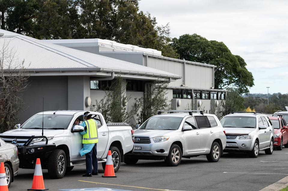 People line up in their cars at Sydney's Crossroads Hotel to get tested in Casula.