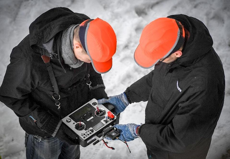 Aerones CEO Janis Putrams (L) says drone technology could be used in firefighting and rescue work (AFP Photo/Ilmars ZNOTINS)