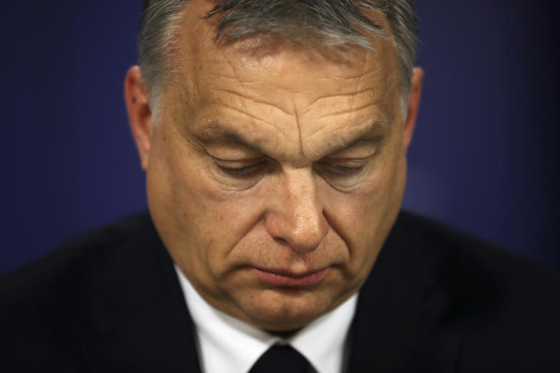 Hungarian Prime Minister Viktor Orban arrives at a news conference following an European People's Party meeting at the European Parliament in Brussels, Wednesday, March 20, 2019. (AP Photo/Francisco Seco)
