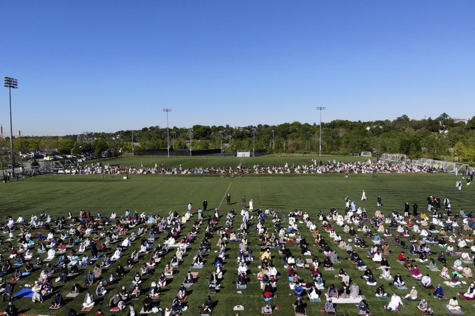 More than 2000 people participate in Eid al-Fitr prayers in Overpeck County Park in Ridgefield Park, N.J., Thursday, May 13, 2021. Millions of Muslims across the world are marking a muted and gloomy holiday of Eid al-Fitr, the end of the fasting month of Ramadan - a usually joyous three-day celebration that has been significantly toned down as coronavirus cases soar. (AP Photo/Seth Wenig)