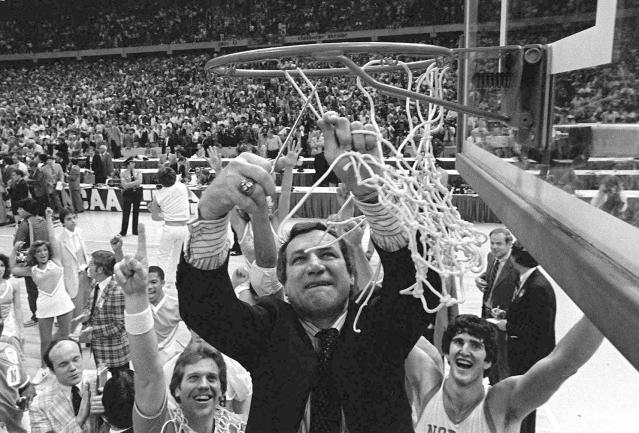 FILE - In this March 29, 1982, file photo, North Carolina basketball coach Dean Smith cuts the net as happy players and fans cheer after the Tar Heels defeated Georgetown for the NCAA college basketball Final Four championship, in New Orleans. The NCAA championship was the only thing missing from Smith's trophy case in an otherwise brilliant career that includes one of the best records in coaching 468-145 over 21 years in Chapel Hill an Olympic gold medal and acknowledgment by peers of his basketball greatness. (AP Photo/Pete Leabo, File)