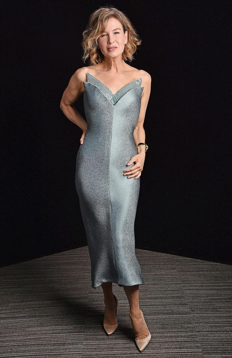 """<p>in a custom Armani Privé cerulean blue cocktail dress with crystal-embroidered neckline and David Webb jewels.</p> <p>""""Renée radiated in this luminous custom Armani Privé dress,"""" the star's stylist <a href=""""https://www.instagram.com/petraflannery/?hl=en"""" rel=""""nofollow noopener"""" target=""""_blank"""" data-ylk=""""slk:Petra Flannery"""" class=""""link rapid-noclick-resp"""">Petra Flannery</a> tells PEOPLE. """"I loved the angular beaded neckline.""""</p>"""