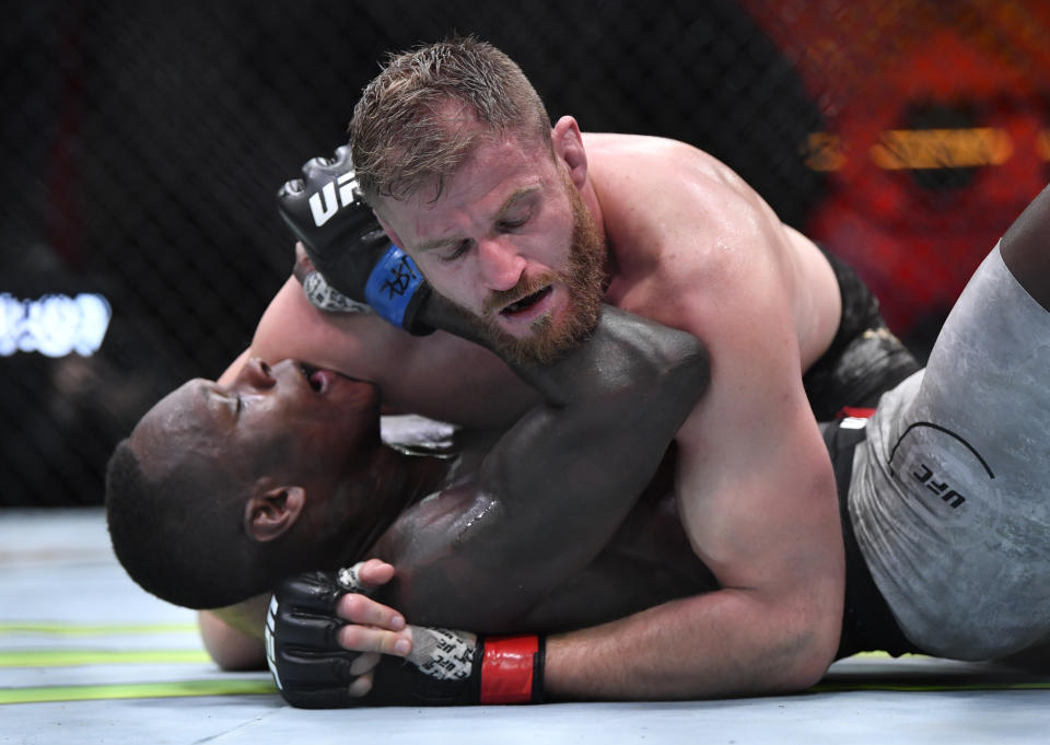 LAS VEGAS, NEVADA - MARCH 06: (R-L) Jan Blachowicz of Poland controls Israel Adesanya of Nigeria on the ground in their UFC light heavyweight championship fight during the UFC 259 event at UFC APEX on March 06, 2021 in Las Vegas, Nevada. (Photo by Chris Unger/Zuffa LLC)