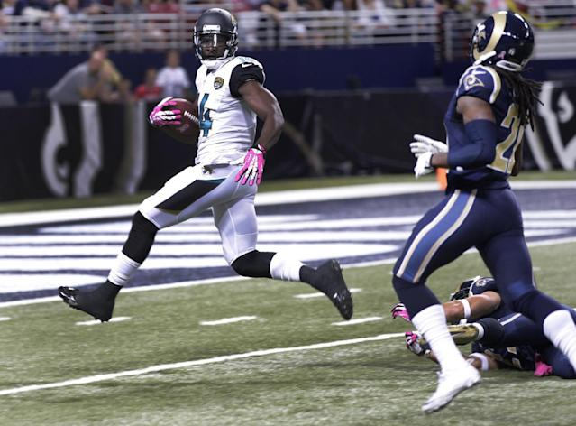 Jacksonville Jaguars wide receiver Justin Blackmon, left, runs past St. Louis Rams cornerback Janoris Jenkins after catching 64-yard pass for a touchdown during the first quarter of an NFL football game Sunday, Oct. 6, 2013, in St. Louis. (AP Photo/Tom Gannam)