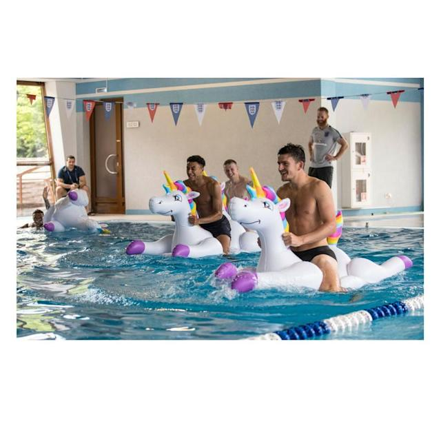 Kieran Trippier, Jordan Pickford, Jesse Lingard and Harry Maguire play with inflatable unicorns in the pool during a recovery session at the ForRestMix Hotel in Repino (REX)