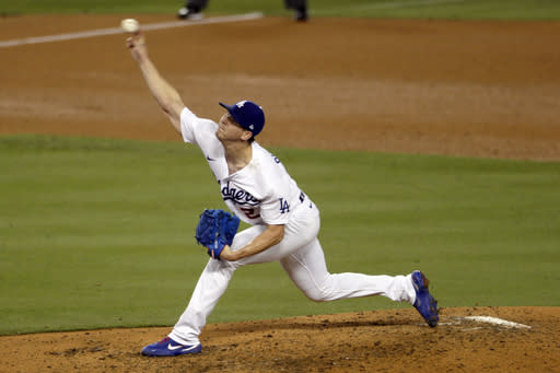 Buehler strikes out 11, Dodgers beat Rox 5-1 for 20th win