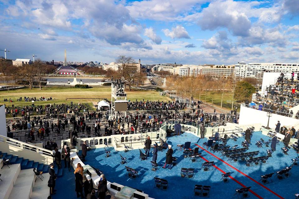 <p>A general view as attendees arrive ahead of the inauguration of President-elect Joe Biden on the West Front of the U.S. Capitol on January 20, 2021, in Washington, D.C.</p>