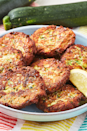 """<p>These simple fritters are quickly shallow-fried and make a great side dish for dinner or a light lunch. They can even be easily adapted to fit whatever you're looking for! </p><p>Get the <a href=""""https://www.delish.com/uk/cooking/recipes/a32954264/easy-zucchini-cakes-recipe/"""" rel=""""nofollow noopener"""" target=""""_blank"""" data-ylk=""""slk:Courgette Cakes"""" class=""""link rapid-noclick-resp"""">Courgette Cakes</a> recipe.</p>"""