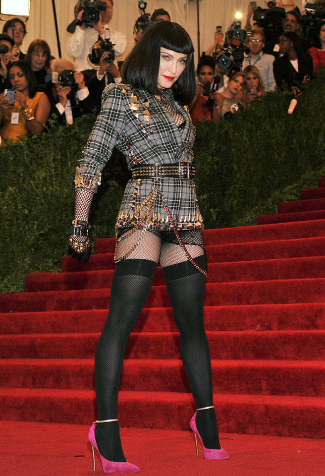Madonna saved the day by brilliantly applying the punk theme in a plaid Givenchy Haute Couture by Riccardo Tisci ensemble adorned with lots of studs and chains. Wearing a black bobbed wig and hot pink pumps, she embodied a rebel spirit, but looked quite at home at the black tie fundraiser.