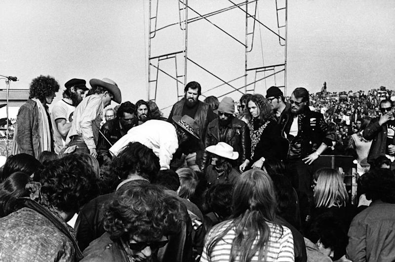 Marty Balin of Jefferson Airplane (on the ground in the white hat) is surrounded Hells Angels at the Altamont Speedway on Dec. 6, 1969 in Livermore, Calif. (Photo: Robert Altman/Michael Ochs Archives/Getty Images)