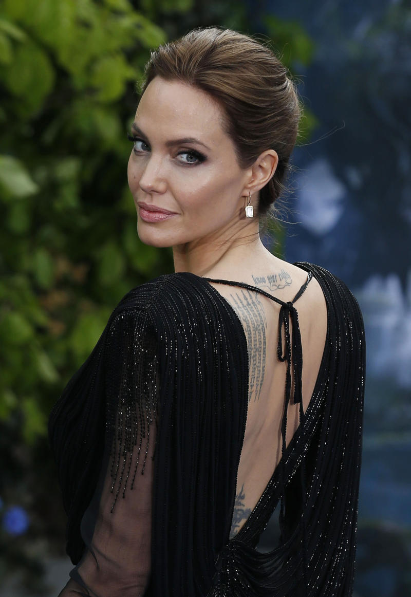 Angelina Jolie attending the premiere of Maleficent at Kensington Palace, London.