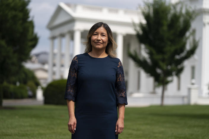 White House Intergovernmental Affairs director Julie Chavez Rodriguez stands outside the White House, Wednesday, June 9, 2021, in Washington. The granddaughter of the late Latino labor activist Cesar Chavez, Rodriguez advises the president and helps state, local and tribal governments with their federal government needs. When Biden spruced up the Oval Office, he gave Cesar Chavez's bust a prominent place among family photographs on a desk behind him. People who know Rodriguez say she's a humble public servant. Her grandfather's activism helped create the United Farm Workers union. (AP Photo/Evan Vucci)
