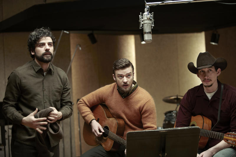 """FILE - This file film image released by CBS FIlms shows, from left, Oscar Isaac, Justin Timberlake and Adam Driver in a scene from """"Inside Llewyn Davis."""" In the Coen brothers film, Timberlake plays a supporting role as a cheery, sweater-wearing 1960s folk musician. But he also collaborated with producer T Bone Burnett on the movie's memorable period songs and helped shape the film's most unforgettable and comic tune, """"Please Mr. Kennedy."""" (AP Photo/CBS FIlms, Alison Rosa, File)"""